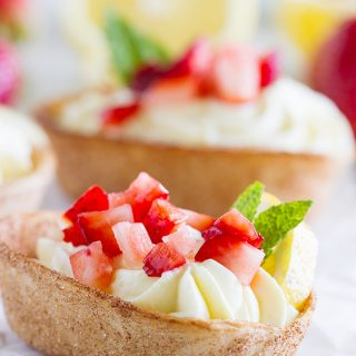 Light and lemony, these Lemon Cream Taco Boats have cinnamon-sugar coated tortilla boats filled with a creamy, luscious lemon cream. Top them off with diced strawberries for a perfect summer treat.