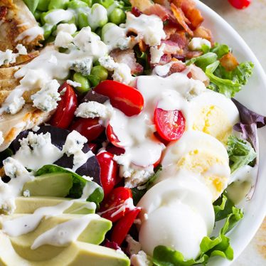 Looking to up your protein game? This Protein Packed Cobb Salad Recipe is not only delicious and filling, but filled with protein.