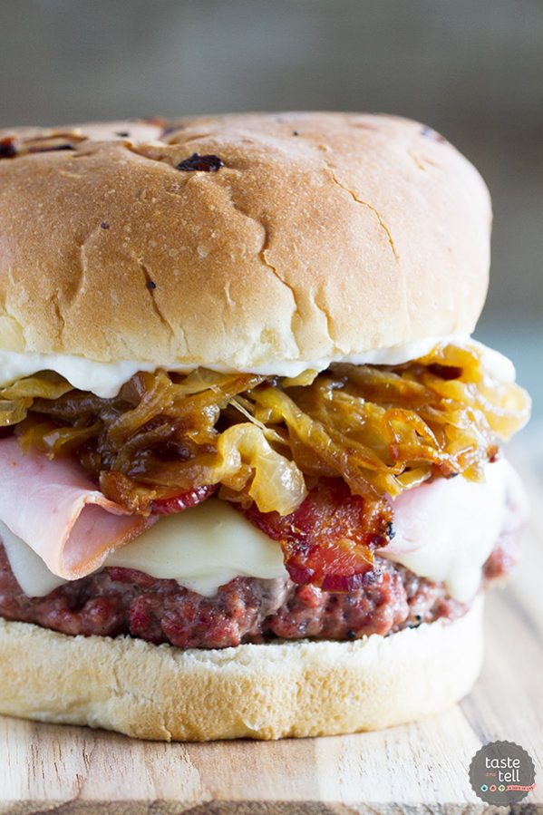 The ultimate hamburger! Pork lovers will go crazy for these Triple Pork Burgers - beef and pork patties topped with ham, bacon, and lots of caramelized onions. It's a flavor explosion!