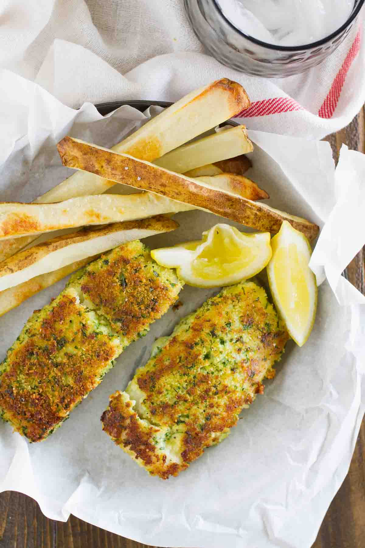 Lemon herb fish with crispy oven fries taste and tell for Fish in oven