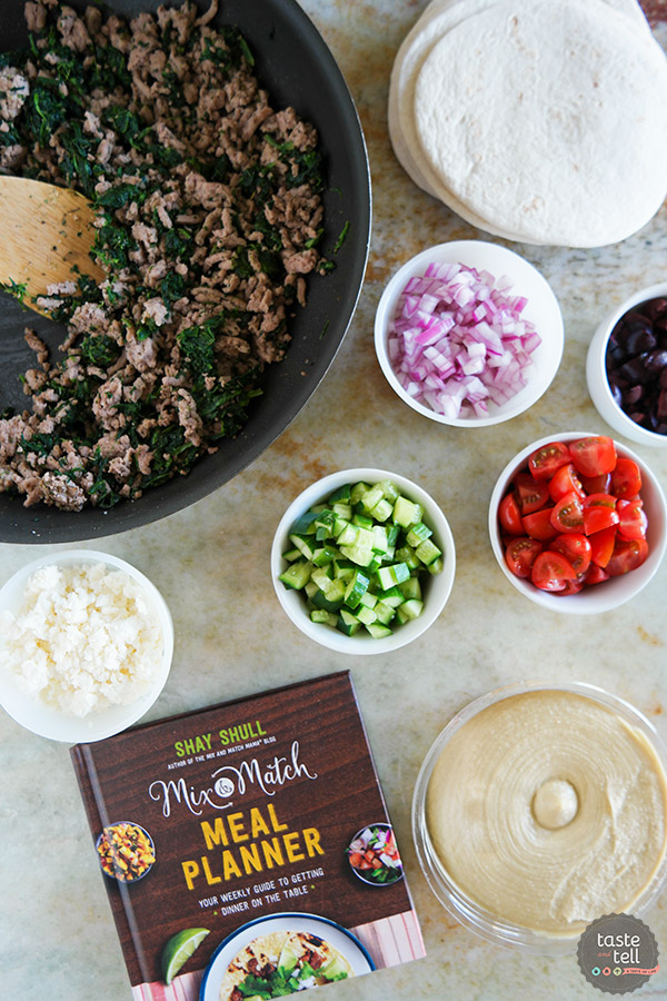 These Greek Tacos are anything but boring - filled with ground turkey with spinach and topped with hummus, feta, and lots of veggies. Give your Taco Tuesday some excitement!