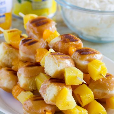 Keep your summer dessert fresh and easy with these Grilled Donut and Fruit Kabobs with Mascarpone Cream. Donut holes, pineapple chunks and mandarin oranges are grilled and served with a luscious cream.