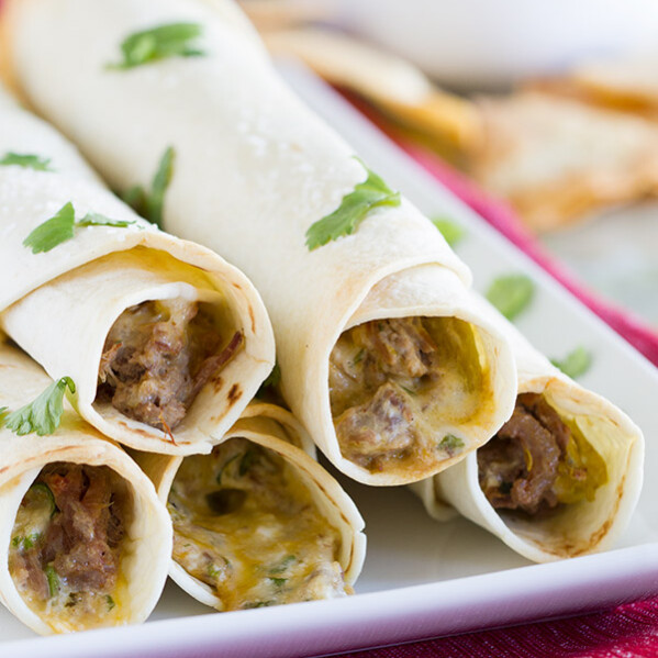 Forget the frying - these Mexican Shredded Beef Baked Taquitos are crisp and flavorful without the added calories. They freeze well, too!