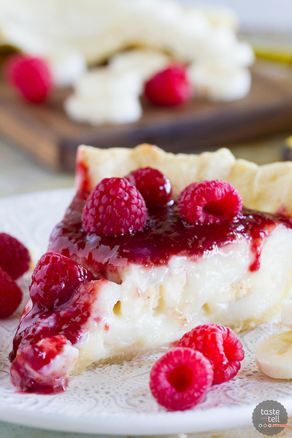 Banana cream pie meets raspberry goodness in this Raspberry Banana Pie recipe that is sweet and creamy and perfect. Who would have ever guessed that raspberry and banana were such a perfect match?