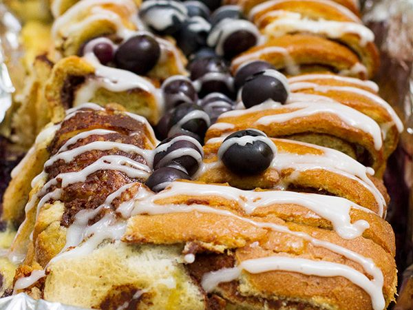 Breakfast while camping doesn't have to be complicated - this Campfire Cinnamon Blueberry Bread Recipe is proof of that! Reminiscent of a baked French toast, your mornings in the woods will be delicious!