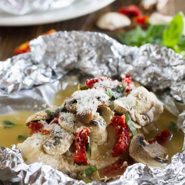 Healthy and fast, this Chicken Milano Foil Packet Recipe is great for a weeknight. The chicken is moist and flavorful, and clean up is a breeze!