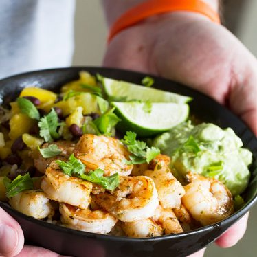 Sweet, spicy and savory - these Spicy Shrimp Bowls have it all going on! Made with rice, beans, pineapple, mango, avocado and spicy shrimp, these bowls are light yet comforting.