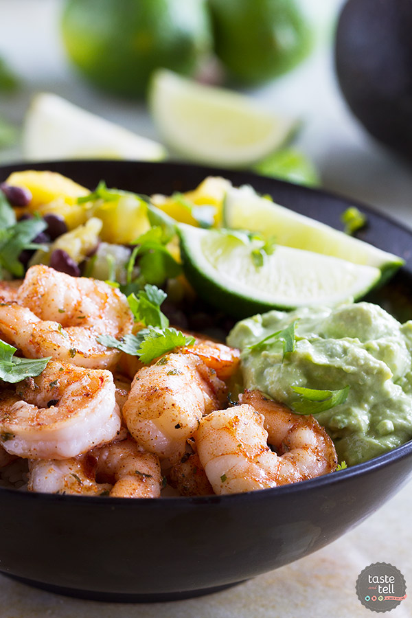 Sweet, spicy and savory - these Spicy Shrimp Bowls have it all going on! Made with coconut rice, beans, pineapple, mango, avocado and spicy shrimp, these bowls are light yet comforting.
