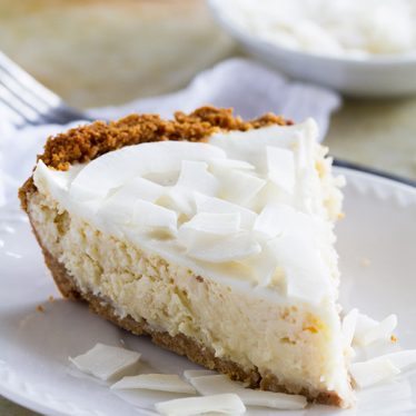 Creamy and coconutty, this Coconut Cheesecake Pie is the perfect dessert for when you can't decided between cheesecake and pie!