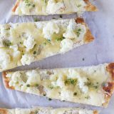 Perfect for an easy, vegetarian lunch, this Easy Flatbread Recipe with Cauliflower and Gruyere only takes minutes to make and is filling and full of flavor.