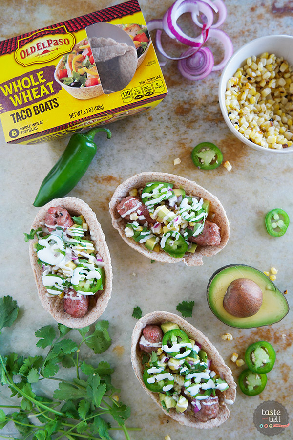 Load it up! These Tex-Mex Bratwurst Boats are filled will all kinds of goodness and are easy to eat because they are served up in a tortilla boat instead of on a bun!