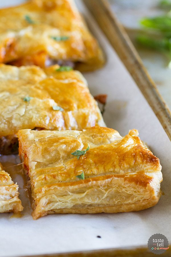 The perfect fall recipe - this Sausage and Butternut Squash Slab Pie is filled with comfort! Sausage, butternut squash and cheese are a perfect match!