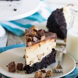 Peanut butter cup lovers - this one's for you! This Peanut Butter Cup Ice Cream Cake is a dark chocolate cake that is topped with a no-churn peanut butter ice cream layer and finished off with chocolate ganache.