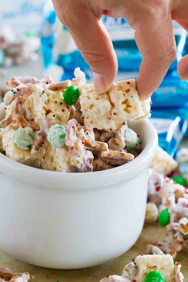 This Sweet and Salty Christmas Mix is the perfect snack to have around during the holiday season! With Rice Krispies treats, chocolate candies, pretzels, peanuts and white chocolate, it's perfect for parties, watching holiday movies, or for snacking on while searching for the best holiday light displays.