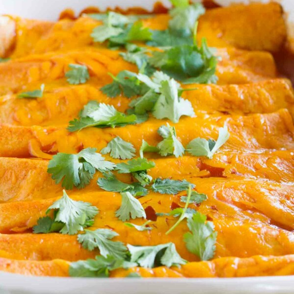 There is more to Thanksgiving leftovers than turkey sandwiches! These Thanksgiving Leftover Enchiladas are a great way to turn those leftovers into something different and delicious.