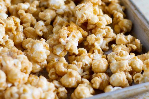 An easy recipe for homemade caramel popcorn – this Baked Caramel Popcorn is made from a simple brown sugar caramel, and then baked until perfectly crispy.