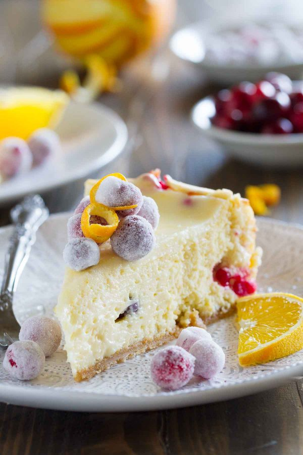 This Cranberry Orange Cheesecake is a showstopper – an orange scented cheesecake is filled with fresh cranberries, then topped with sweet sugared cranberries. It is so creamy and delicious – no one will believe that it's homemade!