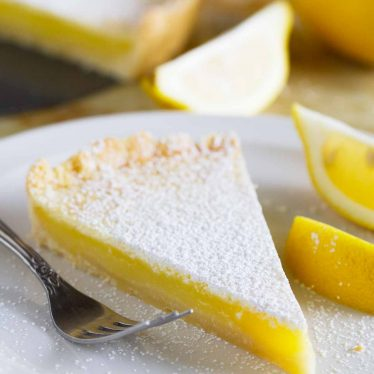 Perfectly sweet and perfectly tart, this Shortbread Lemon Tart Recipe tastes like the best lemon bars in pie form.