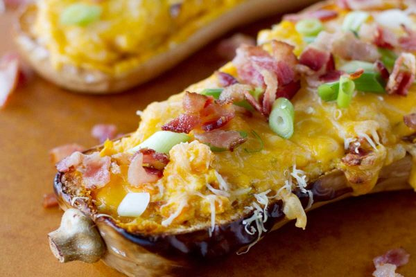 Roasted butternut squash is mashed with lots of cheese and bacon (or omit the bacon for a vegetarian meal!) and then stuffed back into the squash skins and baked in this filling and comforting Double-Stuffed Butternut Squash.