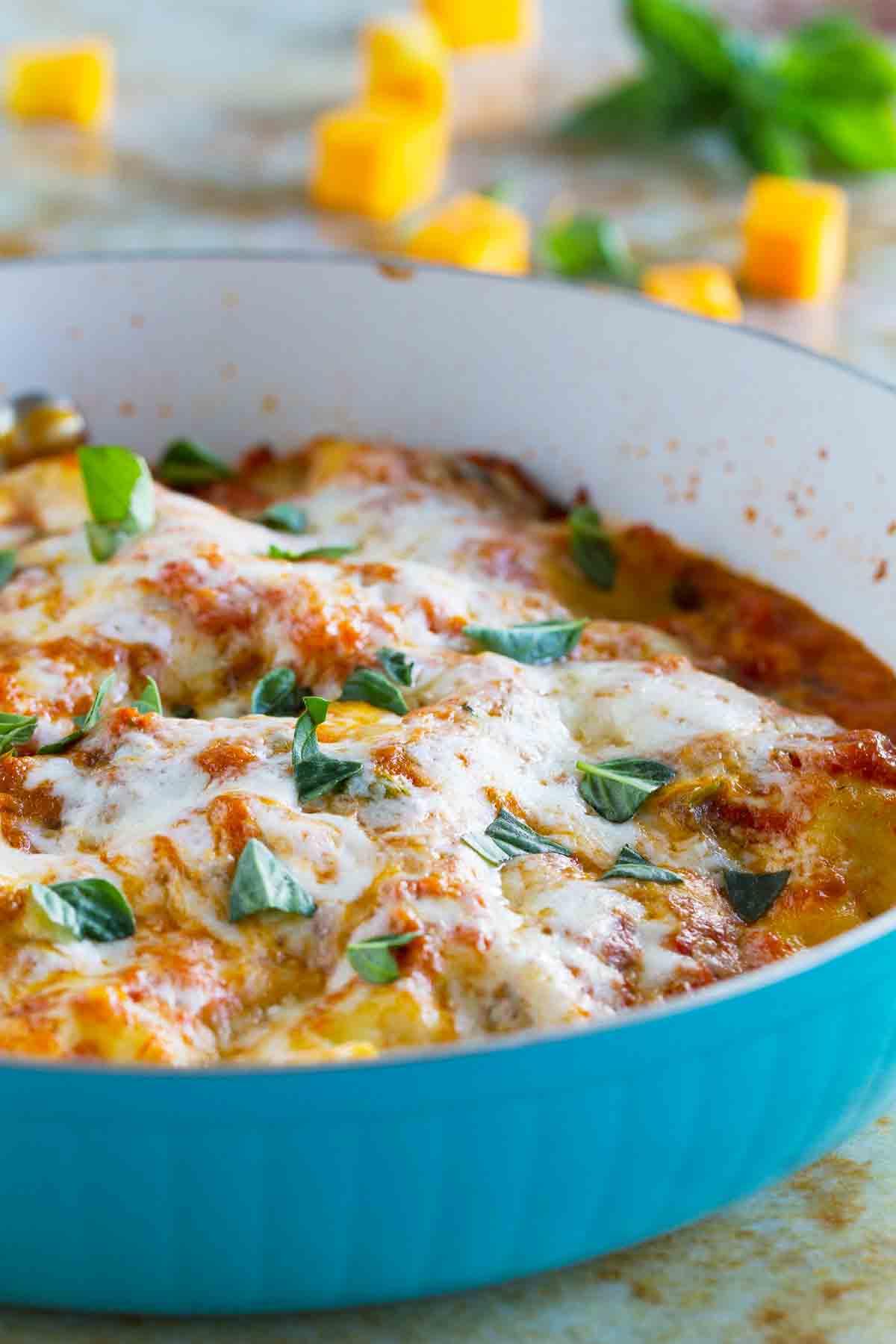 blue skillet with butternut squash lasagna