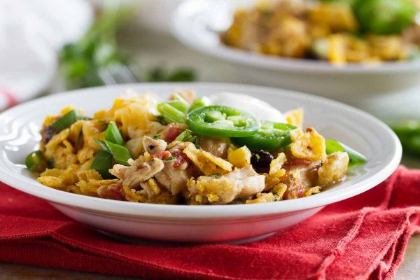 Look no further for an easy slow cooker dinner recipe! This Slow Cooker Cheesy Chicken and Frito Casserole comes together quickly and you can never go wrong when there are Fritos involved!