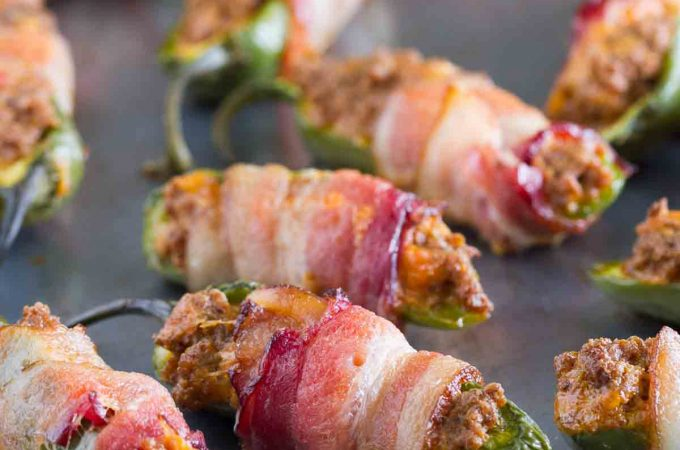 What is better than cheese stuffed jalapeños? Taco stuffed jalapeños, wrapped in bacon! These Taco Stuffed Bacon Wrapped Jalapeño Poppers take a normal jalapeño popper and give them a delicious Tex-Mex twist.