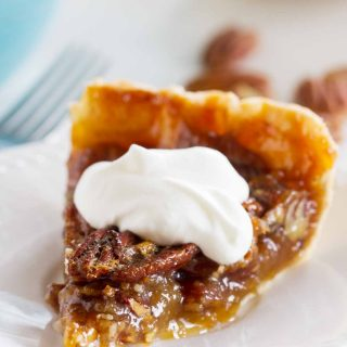 You can't beat a classic, and it doesn't get more classic than this Classic Pecan Pie recipe. Perfectly sweet with a wonderful crunch from the pecans, this is the best traditional pecan pie recipe!