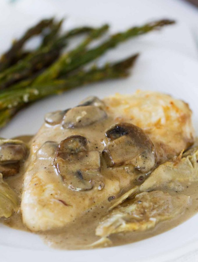 Chicken, mushrooms and artichokes are cooked in a creamy sauce, making this Creamy Artichoke Chicken a dreamy chicken dinner!
