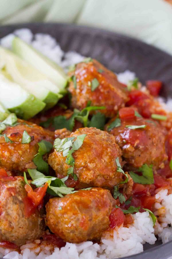 aco spiced meatballs are slow cooked in an easy enchilada sauce. Serve these Tex-Mex Slow Cooker Meatballs over rice or tortilla chips or turn them into a Tex-Mex style hoagie sandwich!