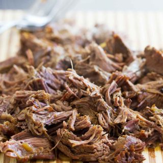 Spice up dinner in a fraction of the time with this Instant Pot Barbacoa Beef! Chipotle and cumin make this perfect for tacos, burritos, enchiladas and more!