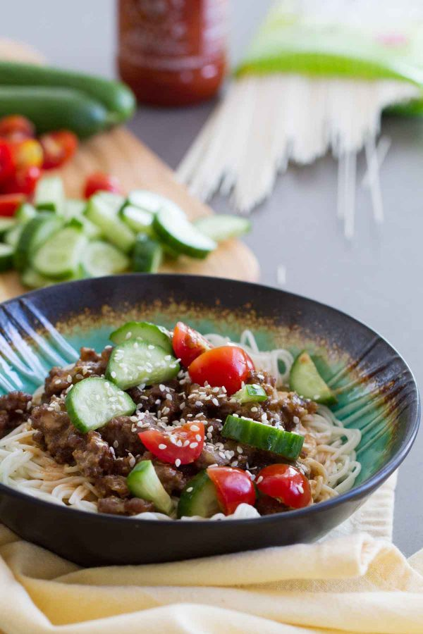 Fast, easy and full of flavor, this Spicy Pork Noodle Bowl recipe is delicious and addictive. Who needs the local noodle place when you can make these at home?