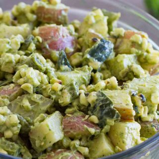 Potato salad with a Tex-Mex twist - this Potato Salad Recipe with Corn and Poblanos combines charred chiles and corn with potatoes and an avocado-cilantro dressing that's irresistible.