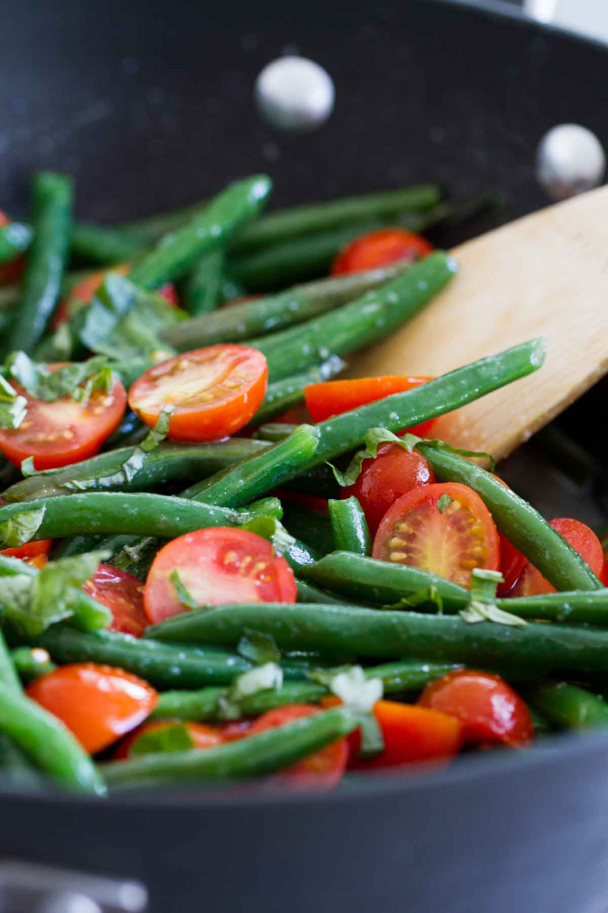 Fresh Sauteed Green Beans in a skillet with cherry tomatoes