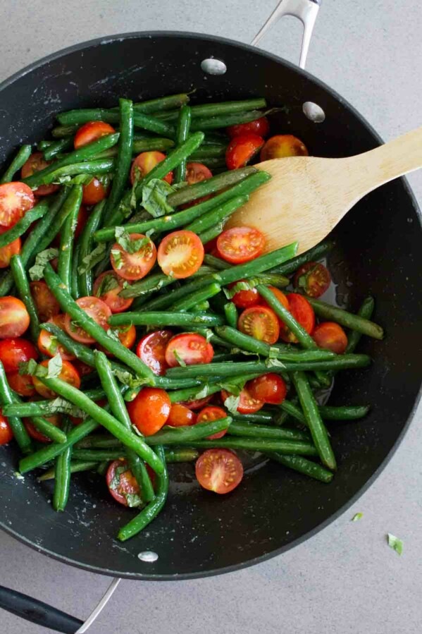 overhead view of sauteed green beans in a saute pan