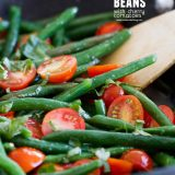 Sauteed Green Beans with Cherry Tomatoes in a pan with text in the corner
