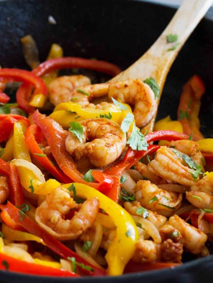 Dinner in a jiffy - these Skillet Shrimp Fajitas are not only good for you, but can be done in under 30 minutes! Peppers, onions and fajita spiced shrimp are all cooked in one skillet for an easy dinner.
