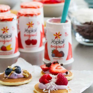 Keep breakfast or after-school snacking fun with these Yogurt Pancake Bites! Silver dollar pancakes are topped with yogurt and assorted toppings for a treat the whole family will love. Make the pancakes ahead of time to make it even easier!