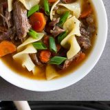 Super tender and slow cooked, this Slow Cooker Beef Noodle Soup is the definition of comfort food! Put it in the slow cooker in the morning, and a flavorful noodle soup is ready for dinner!