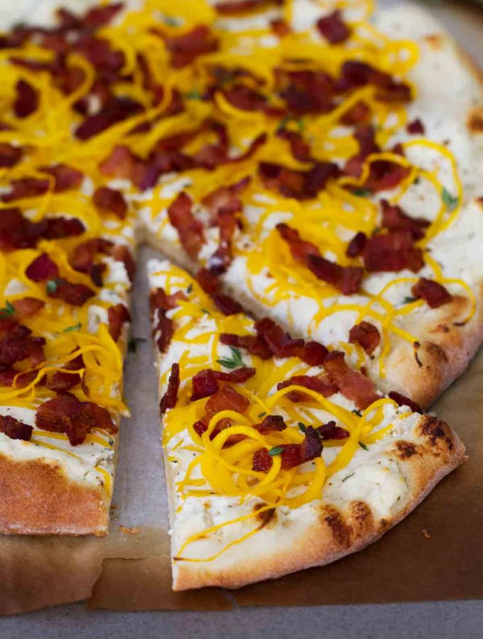 Celebrate fall with this Bacon and Spiralized Butternut Squash Pizza - creamy ricotta cheese is topped with spiralized butternut squash and crispy bacon for a pizza packed with fall flavors.
