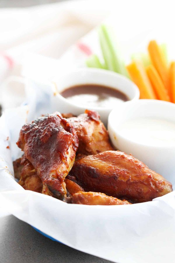 Chicken wings don't get easier than these Slow Cooker Barbecue Chicken Wings! A simple homemade barbecue sauce covers chicken wings that are slow cooked for an easy dinner or appetizer.