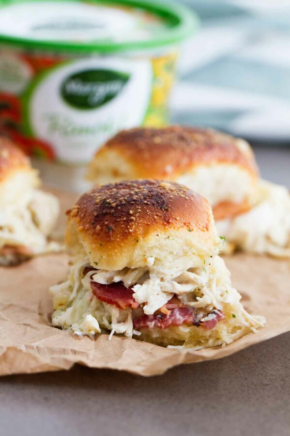 Chicken Bacon Ranch Sliders - ranch chicken, bacon, and cheese get baked inside rolls that are topped with a buttery ranch to make these crowd pleasing sandwiches.