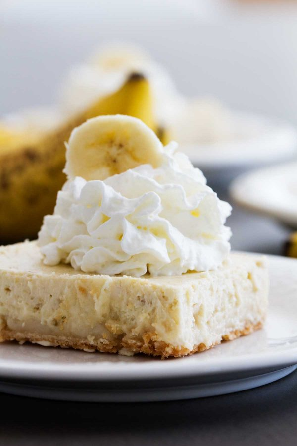 Those leftover bananas are begging to be turned into these Banana Cheesecake Cookie Bars! Super easy and super delicious, these bars will curb that cheesecake craving.