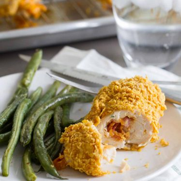 Cheddar and Bacon Stuffed Chicken on a dinner plate
