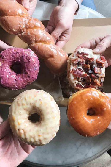 a variety of doughnuts from Sidecar Doughnuts