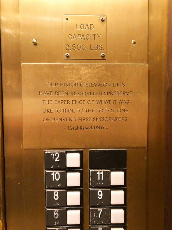elevator plaque in Magnolia Hotel - Denver