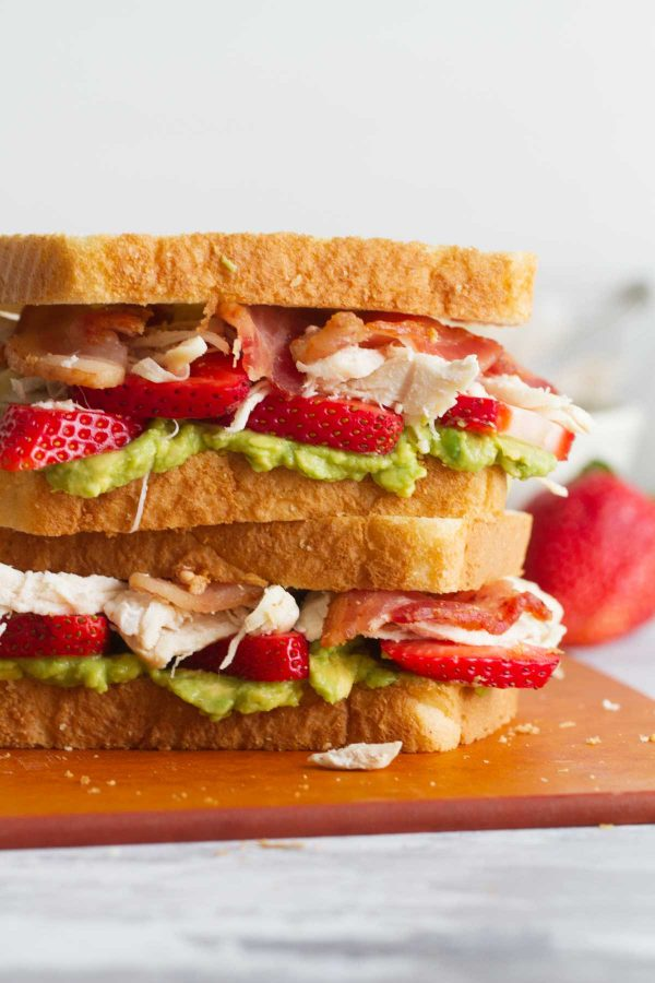 Chicken Club Sandwich with avocado and strawberries