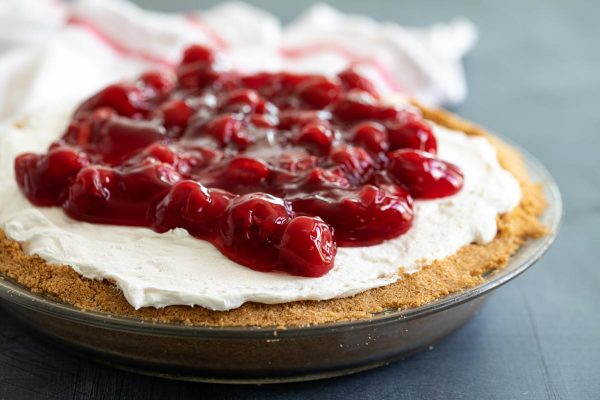 Cheesecake topped with cherries