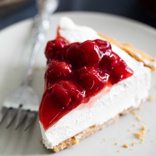 Slice of No Bake Cheesecake with Cherry Topping