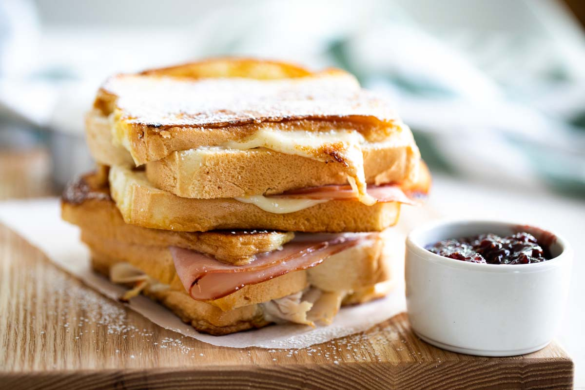 2 full monte cristo sandwiches stacked on top of each other