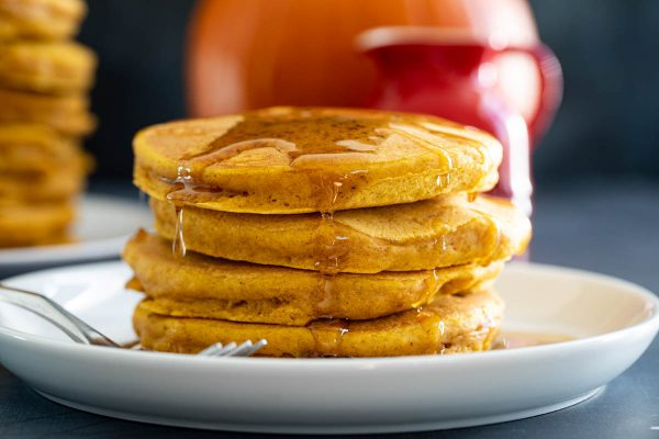 Stack of pumpkin pancakes with syrup
